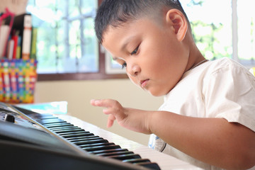 Little Boy playing piano fun