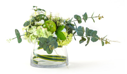 Bouquet of cosmos and eucalyptus in glass vase