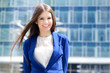 Smiling young businesswoman outdoor