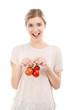 Beaitiful woman holding red tomatos