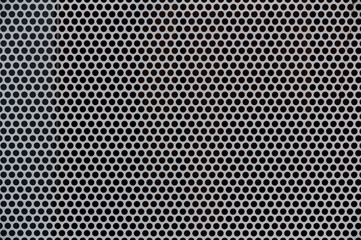 Background of gray metal with holes