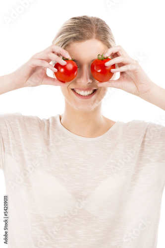 Beaitiful woman with tomatos in front of the face