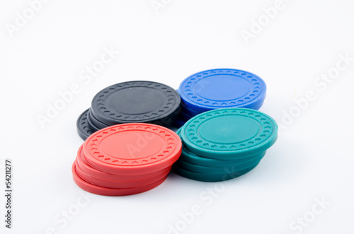 Stacks of poker chips in black, blue, green and red
