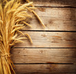 Leinwanddruck Bild - Wheat Ears on the Wooden Table. Harvest concept
