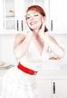 Happy beautiful housewife posing