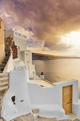 Typical villa overlooking the caldera at dusk in Oia © tobago77
