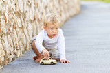 Little boy plaing with car