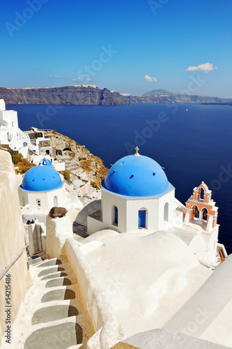Iconic Santorini caldera landscape with greek white churches ove