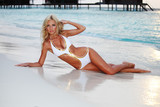 Fototapety woman on the sand the ocean coast