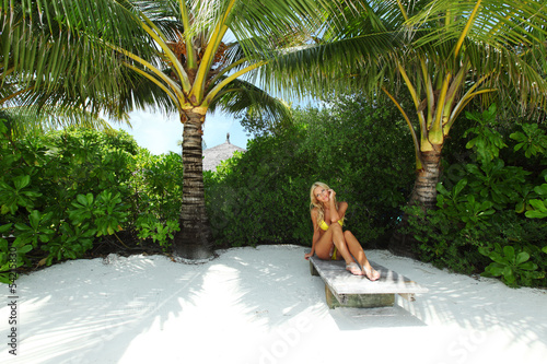 tropical woman on lounge