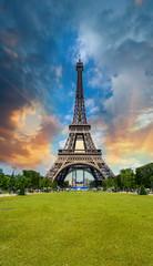 Sunset sky above Eiffel Tower - Paris. La Tour Eiffel from Champ