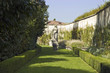 Formal garden with wall and sculpture