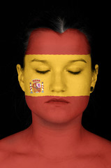woman with the flag of Spain painted on her face.
