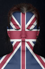 woman with the flag of the UK painted on her face.