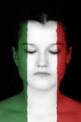 woman with the flag of Italy painted on her face.