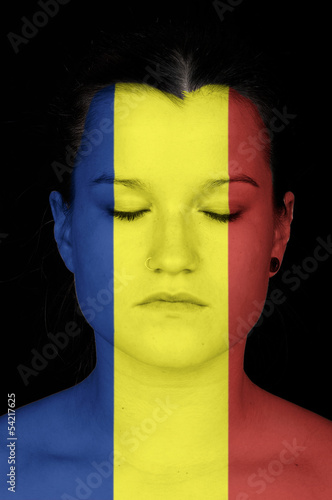 woman with the flag of Rumania painted on her face.