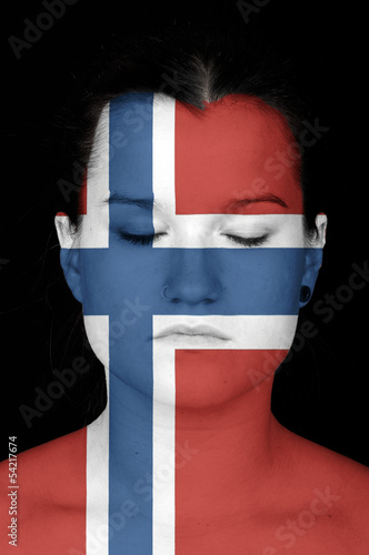 woman with the flag of Norway painted on her face.