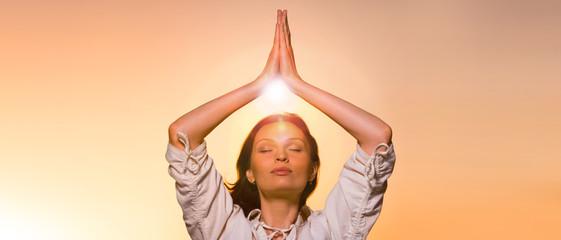 Yoga against the orange sky