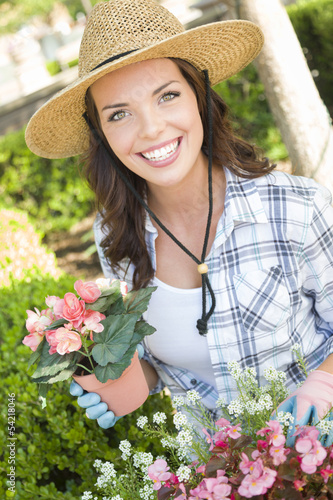 Happy Young Woman Wearing Hat Gardening Outdoors