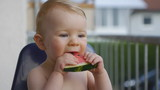 HD1080p25 Baby (10 months old) eating a watermelon on the balcon