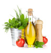 Fresh herbs, tomato, olive oil and pepper shaker