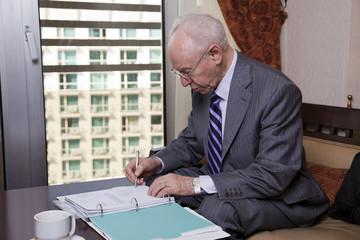 Senior Businessman Writing Notes