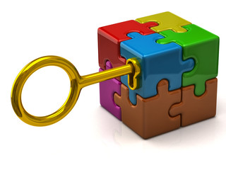 Colorful puzzle cube with golden key.