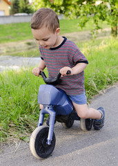 Child riding a toy bike