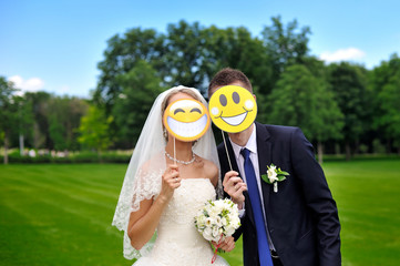 bride and groom with paper smileys