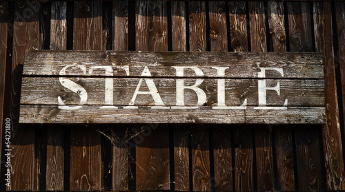 Rustic Sign For A Stable On A Ranch In Western USA