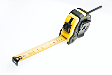 yellow measure tape meter at white background