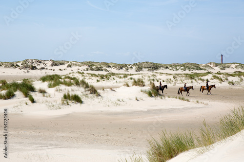 Leinwandbild Motiv Reiter in den Dünen von Norderney
