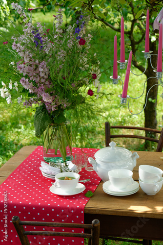 An inviting table is set beautifully and colorfully