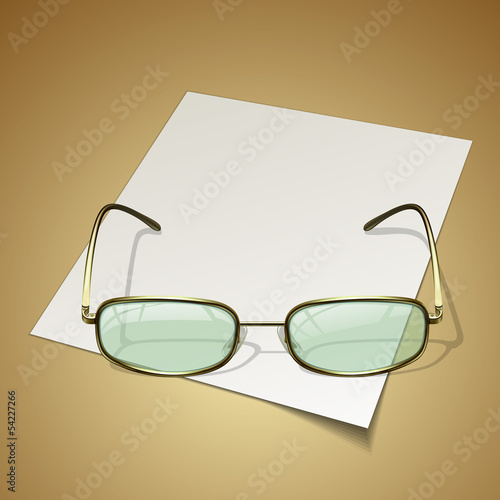 glasses on white paper