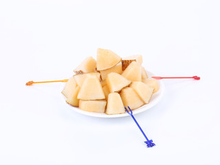Handful melon slices on a white background