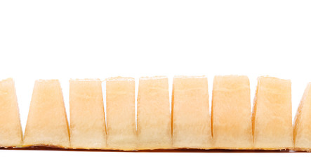 Row melon slices on a white background