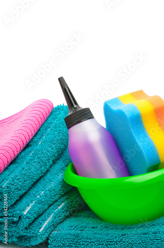 Stack of towels, napkins, sponge, cleaning supplies