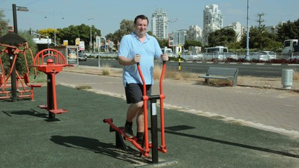 X-trainer working  the users upper and lower body