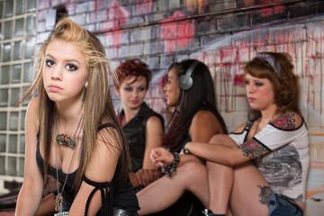 Girls Ignoring Young Teen