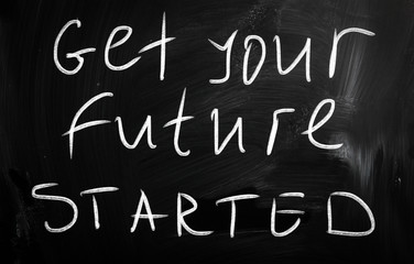 """""""Get your future started"""" handwritten with white chalk on a blac"""