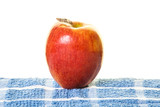 Single Red Apple on Blue Placemat