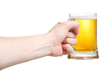 Closeup of a male hand holding up a glass of beer over a white b