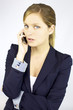 Beautiful blond business woman talking on the phone
