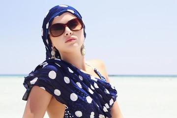 beautiful woman on paradise beach.arabian style