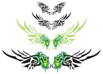 Wings in the form of the horse head and green monster eyes