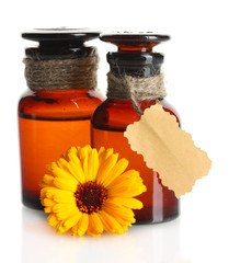 medicine bottles and beautiful calendula flower, isolated