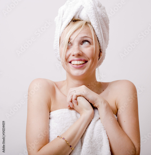 cute blond woman in white towel on her head, after spa or bathro
