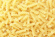 background with close up of spiral fusilli pasta
