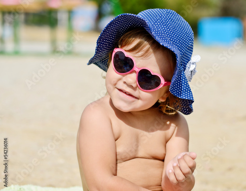 sweet fashion toddler girl on the beach