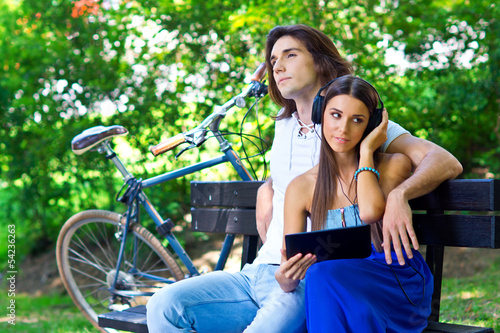 young couple on the park bench